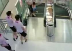 Ticarət mərkəzində faciə: eskalator ananı öldürdü - VİDEO - FOTO