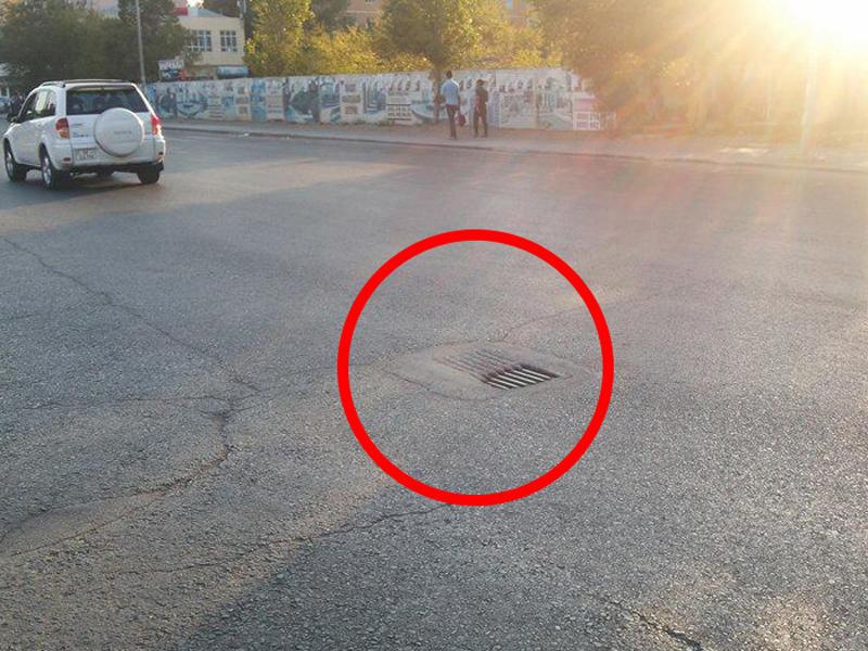 Sumqayıtda su axıdıcılarının üstünü asfaltladılar