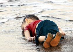 Dünyanı ağladan fotoya görə 4 nəfər həbs olundu