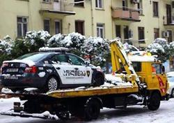 Yol polisi maşını cərimə meydançasına aparıldı - Gürcüstanda - FOTO