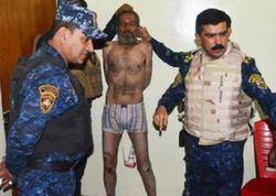 İŞİD-in qəddar komandiri arvad paltarında tutuldu - VİDEO - FOTO