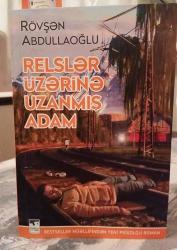 Bestseller müəllifindən yeni psixoloji roman - RELSLƏR ÜZƏRİNƏ UZANMIŞ ADAM - FOTO