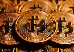 Bitkoin 9 min dollar həddini keçdi