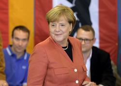Almaniyada parlament seçkilərinin ilkin nəticələri açıqlanıb