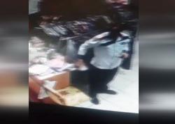 Bakıda mağazadan telefon oğurluğu anbaan kameraya düşdü - VİDEO