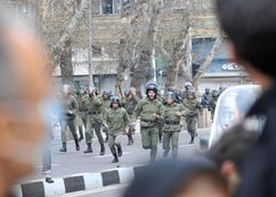 """İran """"qaynayır"""": ölənlərin sayı 5-ə çatdı, 300 saxlanılan var"""