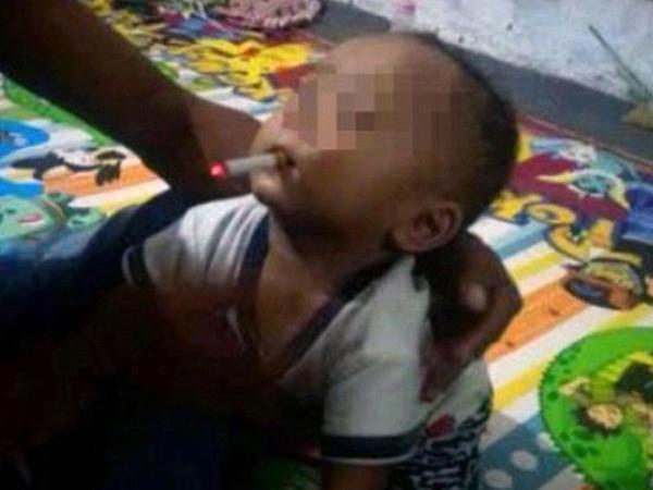 9 aylıq oğluna siqaret verdi, həbs olundu - VİDEO - FOTO