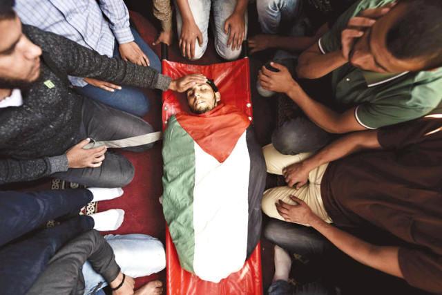 Etiraz aksiyalarına əlil arabasında qatılan müsəlman da öldürüldü - FOTO