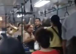 Bakıda yaşlı qadınla gənc qızın avtobusda əlbəyaxa davası – VİDEO