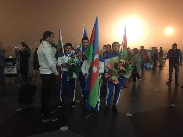 Olimpiadada iştirak etmiş Azərbaycan idmançıları Bakıya qayıdıblar - FOTO