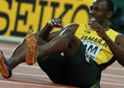 Useyn Bolt futbol karyerasını başa vurub