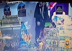Mağazada müştərinin çantasını oğurladılar - FOTO