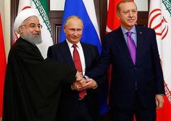Putinin Ərdoğanın sualına cavabı İran prezidentini güldürdü - VİDEO