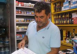 """Adını deməyən şəxs marketin """"nisyə dəftəri""""ni satın aldı"""