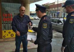 Polis vətəndaşlara tibbi maskalar payladı