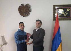 İranlı Əhməd qızıl medalını erməni ailəsinə verdi