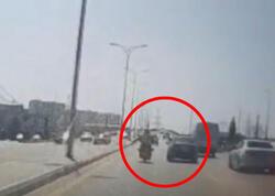 Bakıda avtomobil sürücüsü dəhşət saçdı - Qəsdən motosikletçini vurdu - VİDEO